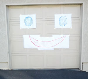 giant smiley face on garage door