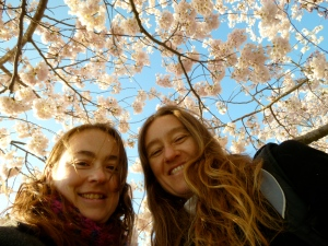 The author and her sister under a blooming cherry tree