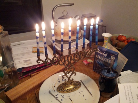 Menorah on a table full of stuff